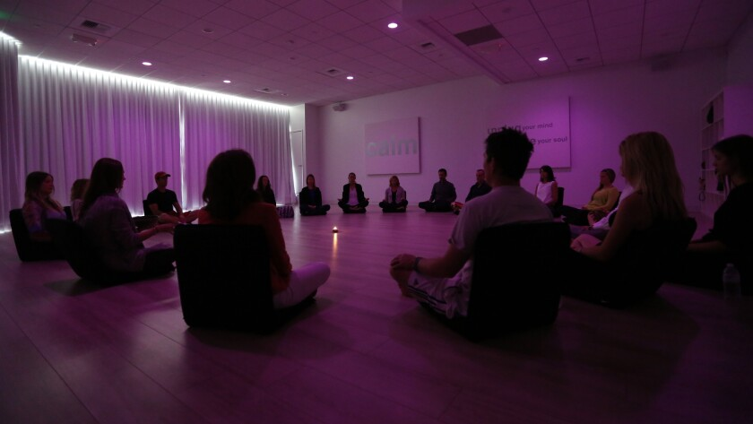Participants meditate during a class at Unplug, a new meditation studio in Los Angeles, on April 24, 2014.