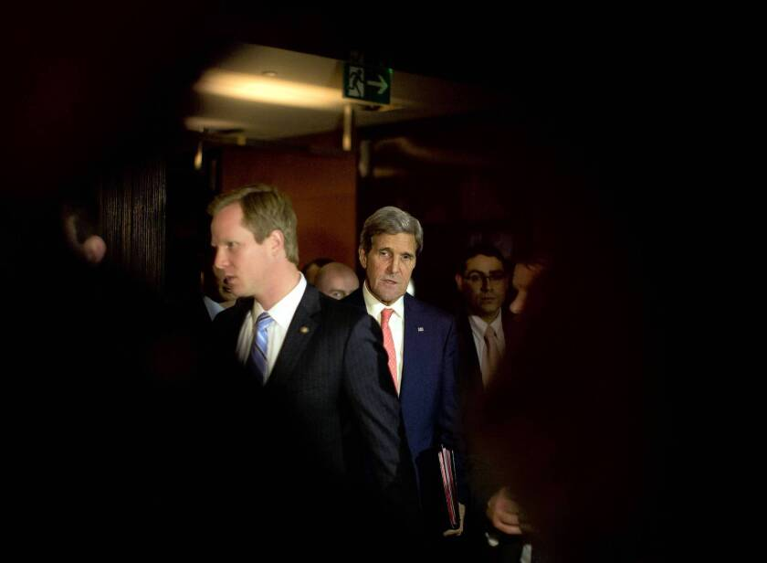 U.S. Secretary of State John F. Kerry, second from left, walks to a meeting Saturday during nuclear talks with Iran in Geneva. After the talks were halted, Kerry said the Obama administration shares many of France's concerns about Iran's heavy-water reactor and medium-enriched uranium.