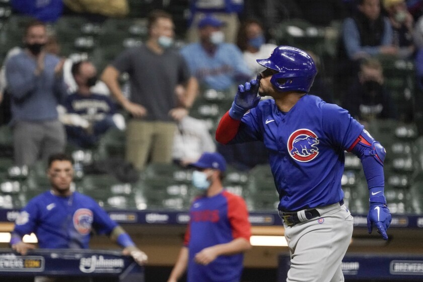 Chicago Cubs' Willson Contreras gestures to the crowd after hitting a two-run home run during the eighth inning of a baseball game against the Milwaukee Brewers Tuesday, April 13, 2021, in Milwaukee. (AP Photo/Morry Gash)