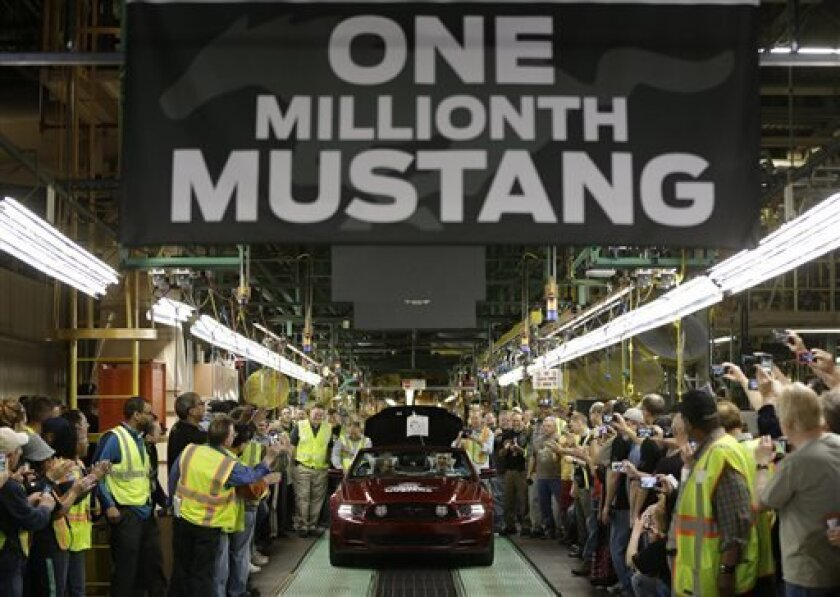 FILE - In this Wednesday, April 17, 2013, file photo Ford's Flat Rock Assembly Plant employees cheer as the millionth Ford Mustang is driven off the assembly line in Flat Rock, Mich. The Institute for Supply Management issues its U.S. manufacturing index for April on Wednesday, May 1, 2013. (AP Photo/Carlos Osorio)