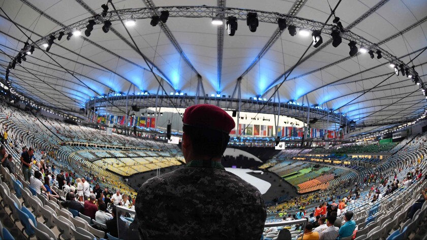 A security guard looks on before the opening ceremony of the Olympic Games at Maracana Stadium in Rio de Janeiro.