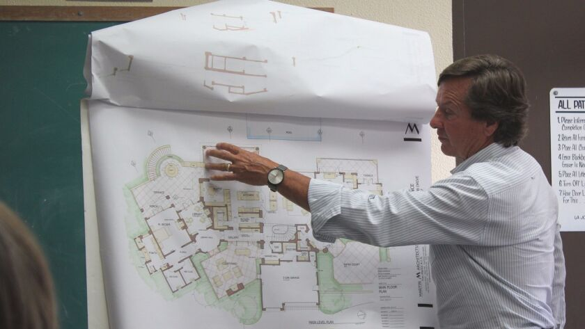 Architect Tim Martin point to the front courtyard of the Country Club Drive project, to be construct