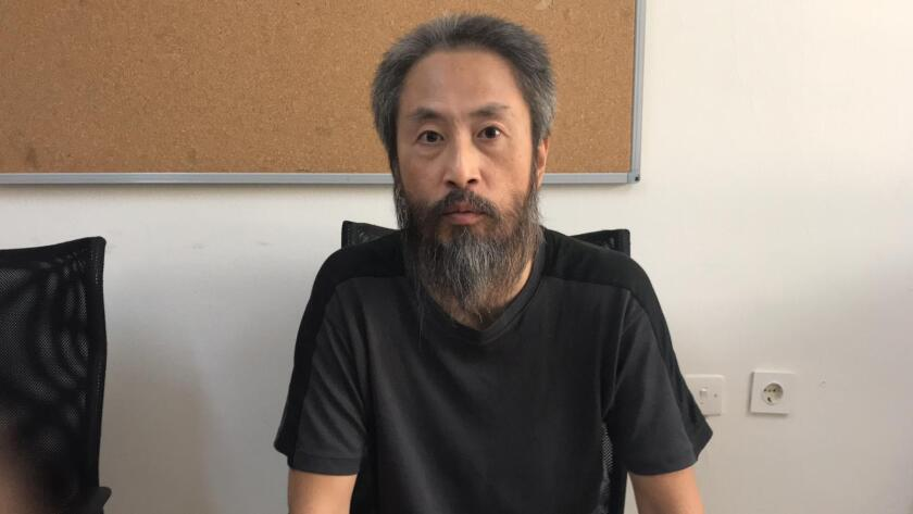 In this image released by the Hatay governorate in Turkey, Jumpei Yasuda of Japan, talks in Antakya,