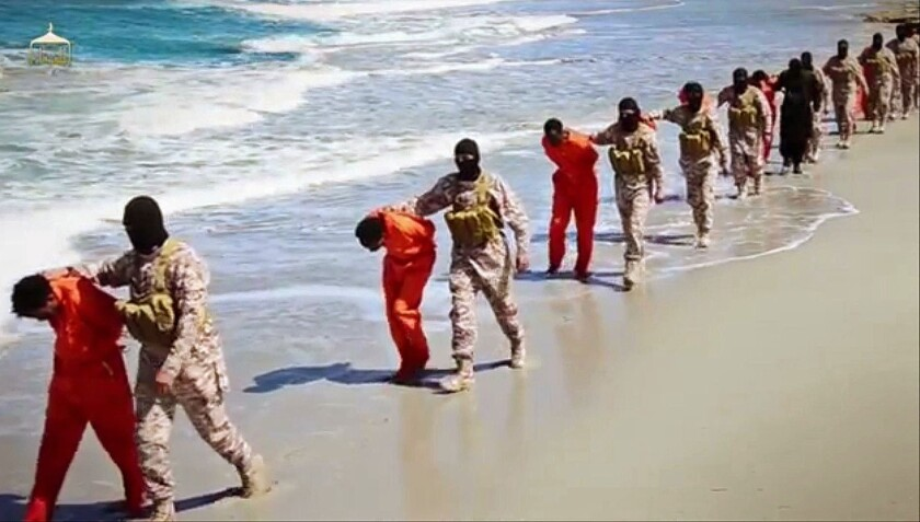 A screenshot from a video released by Islamic State militants Sunday appears to show a group of captured Ethiopian Christians before they are executed in Libya.