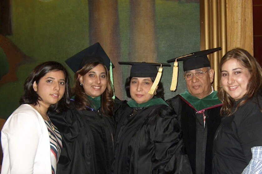 This undated photo provided courtesy of Anisha Khanna, shows, from left, Anisha, Sughanda, Kamlesh, Satyender and Priya Khanna. The northern New Jersey family of five doctors has lost two members to COVID-19. Satyender Khanna, who died at 77, was a practicing surgeon for more than four decades. His daughter, Priya Khanna, who died at 43, specialized in the study of kidney diseases. (Courtesy of Anisha Khanna via AP)