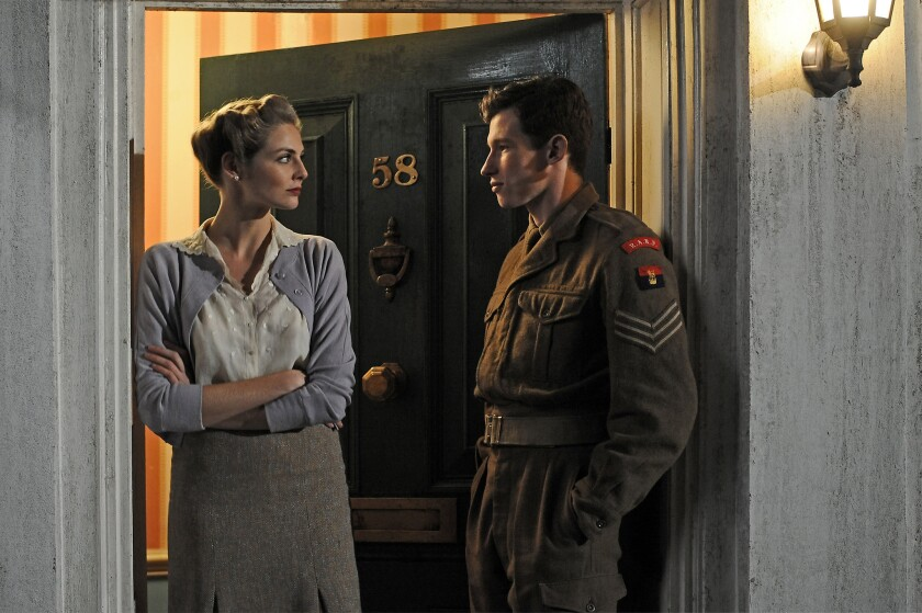 """Tamsin Egerton (Ophelia), left, and Callum Turner (Bill Rohan) in a scene from """"Queen and Country."""""""