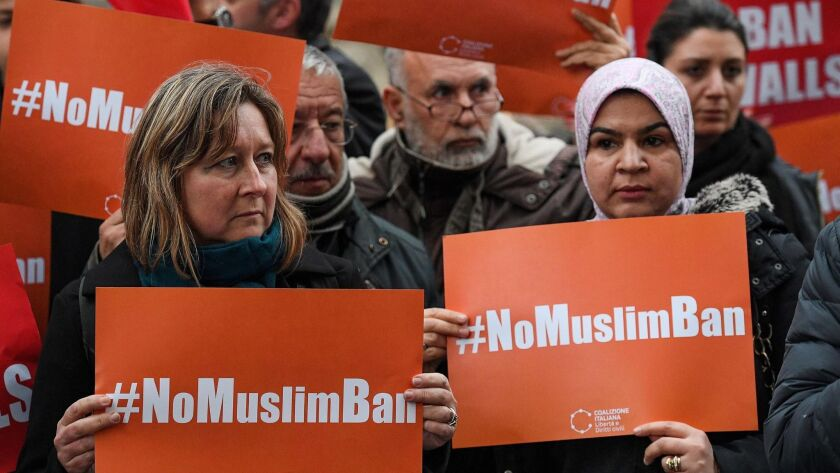 Protesters stage a demonstration against the Trump administration's executive order preventing Muslims from some countries to enter the United States, in front of the US Embassy in Rome on Feb. 2.