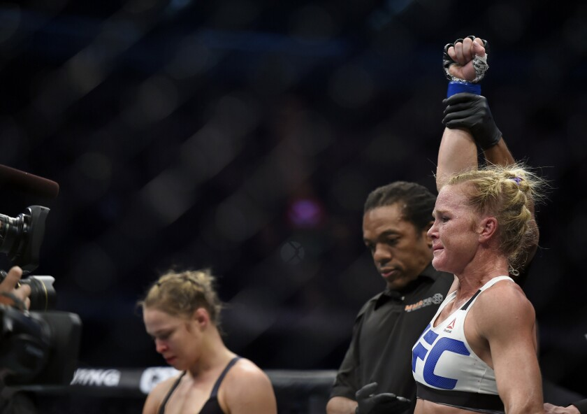 Holly Holm, right, is declared the bantamweight champion after defeating Ronda Rousey at UFC 193.