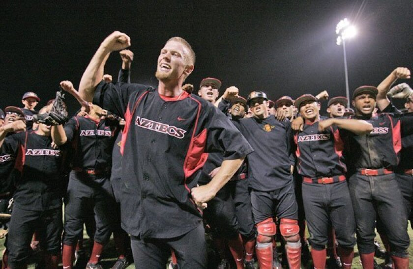 Aztecs pitcher Stephen Strasburg (front) leads a record crowd in singing the SDSU fight song after throwing a no-hitter. (Peggy Peattie / Union-Tribune)
