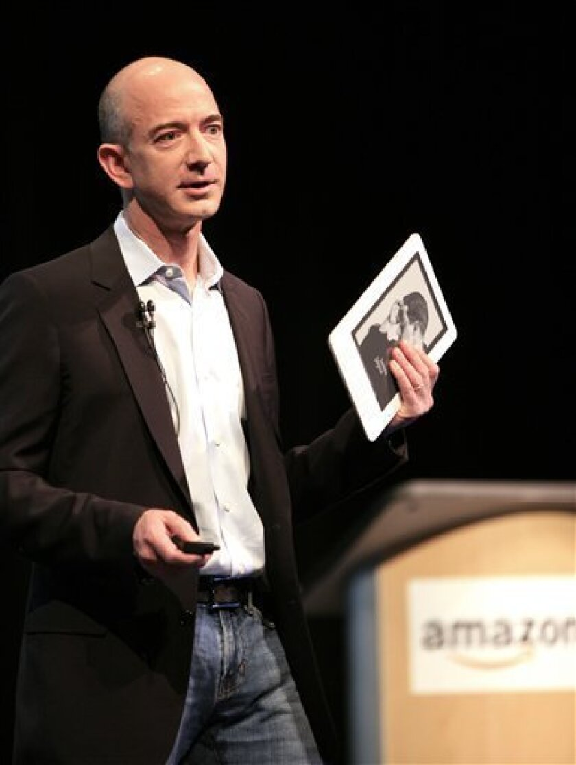Jeff Bezos, CEO of Amazon.com, introduces the Kindle DX at a news conference Wednesday, May 6, 2009 in New York. The Kindle DX has a larger 9.7 inch screen than its predecessor, the Kindle 2, and can be ordered for $489 for delivery this summer. (AP Photo/Mark Lennihan)