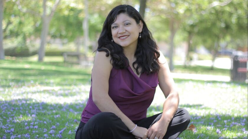 Reyna Grande. Author of the book ' The Distance Between Us'. Published by Simon and Schuster
