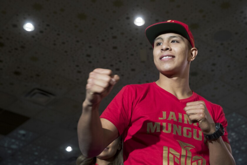 Boxer Jaime Munguia poses with his fists up