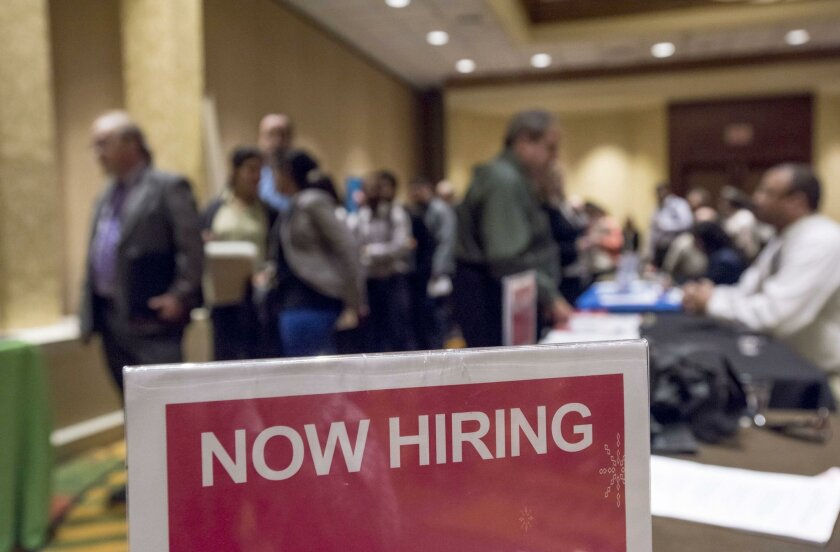 In this file photo from November, job seekers attend a career fair in San Jose. State officials said Friday that unemployment fell to 4.2 percent in May in San Diego County.
