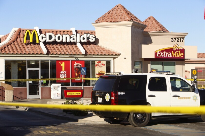 A man was shot to death inside a McDonald's restaurant in Palmdale while he was eating, authorities said.