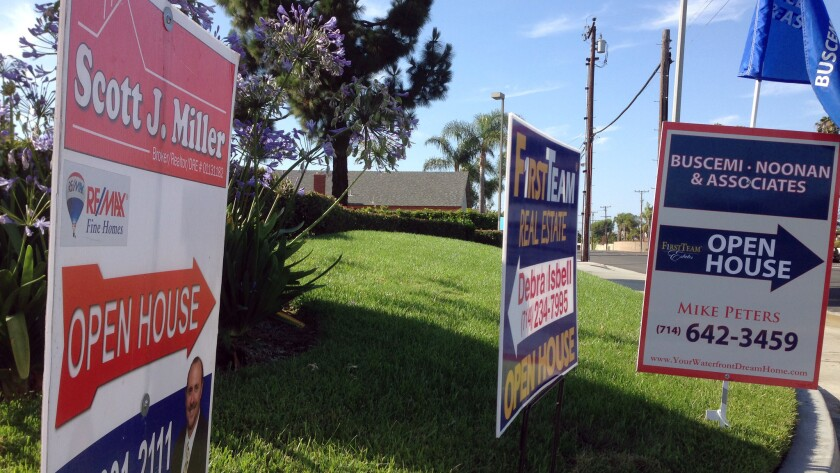Signs in Huntington Beach point to open houses.