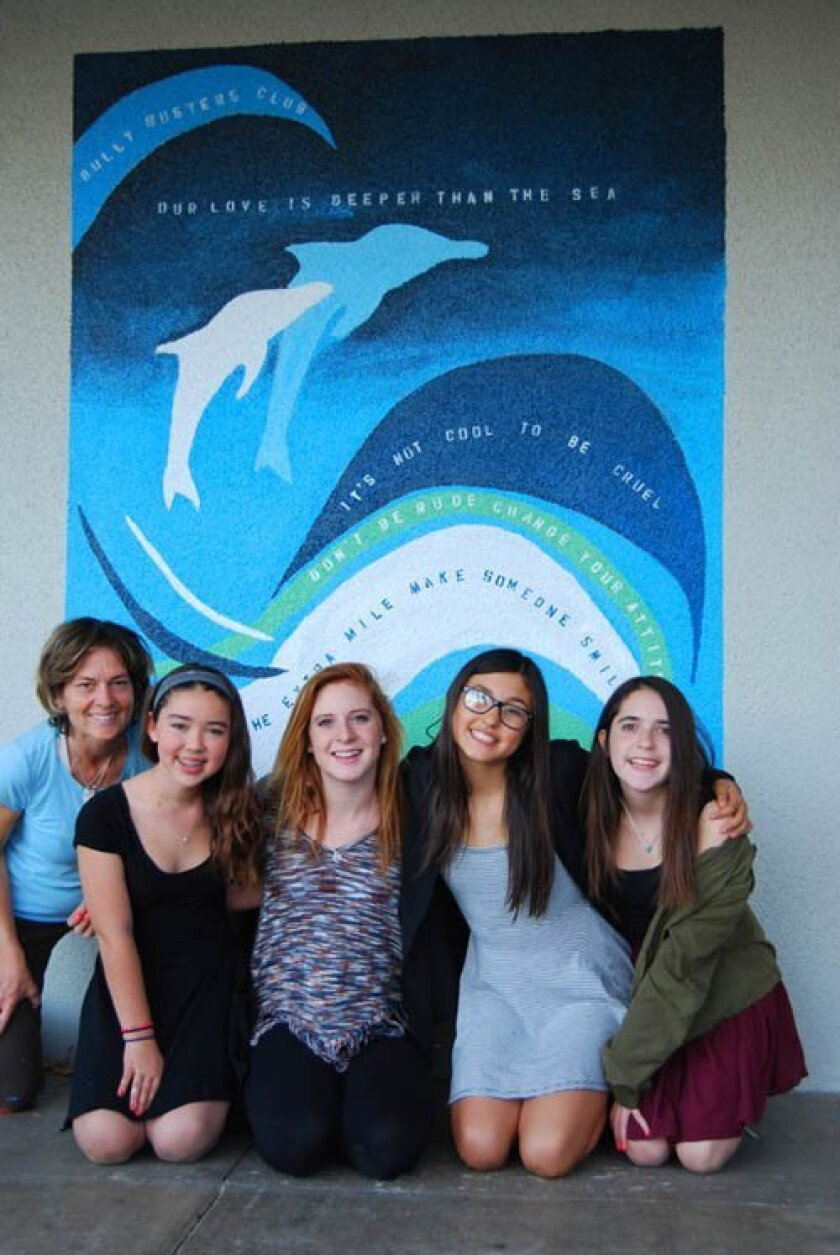 artist Jane Wheeler with Muirlands Middle School students Caroline Garay, Abbie La Grange, Sophia Albasia and Annie Riveroll with the recently completed anti-bullying mural.