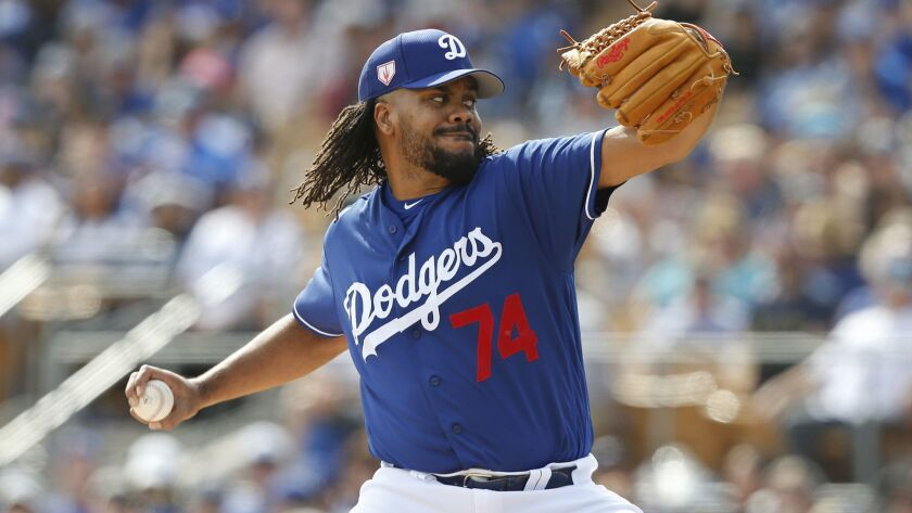 Dodgers pitcher Kenley Jansen pitches during a spring training game in Phoenix.