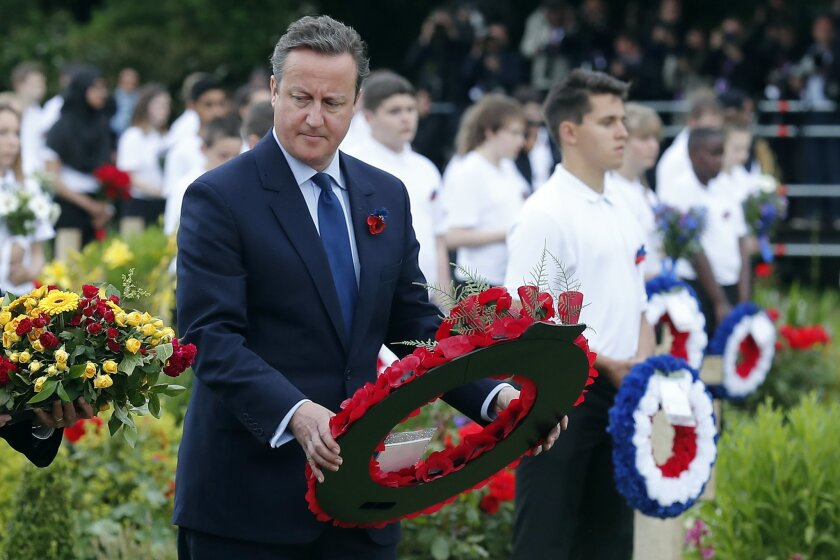 Britain's Prime Minister David Cameron prepares to lay a wreath during a ceremony in the cemetery of the World War I Thiepval Monument during the Somme centenary commemorations in Thiepval, northern France, Friday, July 1st, 2016. One week after Britain's vote to leave the European Union, Prime Min