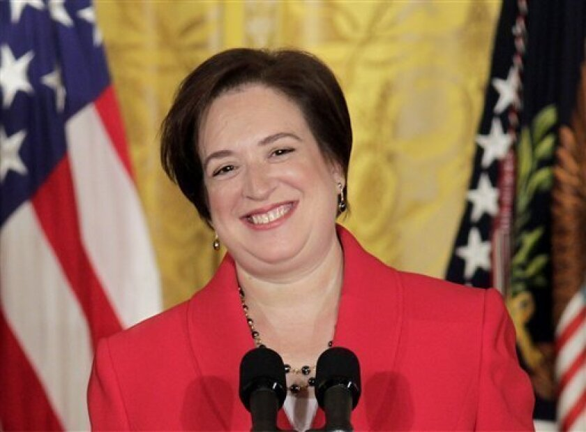 FILE - In this Aug. 6, 2010 file photo, Elena Kagan smiles as she is applauded during a ceremony with President Barack Obama to mark her confirmation to become the next Supreme Court justice, in the East Room of the White House in Washington. First Amendment cases top the Supreme Court's docket as it begins a new term with a new justice and three women on the bench for the first time. (AP Photo/J. Scott Applewhite, File)