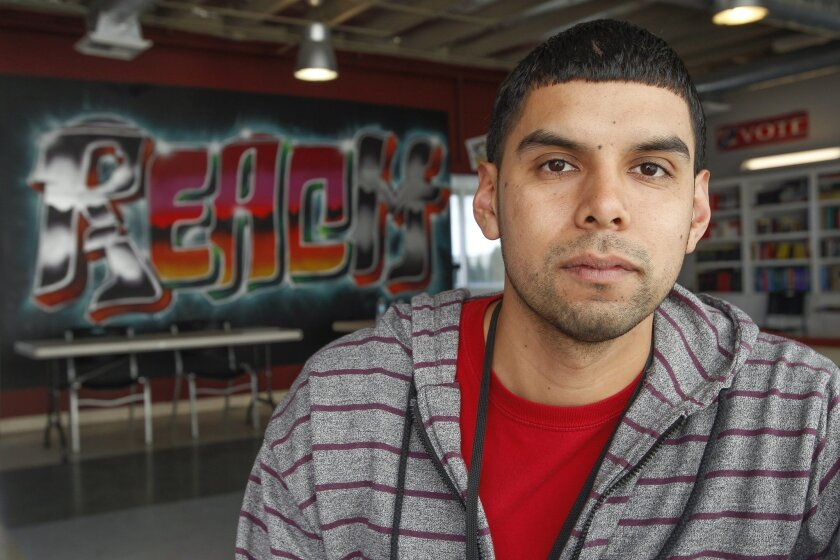 Jimmy Figueroa, an outreach coordinator for Project REACH, is serving the same neighborhood he grew up in — the same one in which he rose from the violence to go to college. He's now working on his law degree . hayne palmour iv • u-t