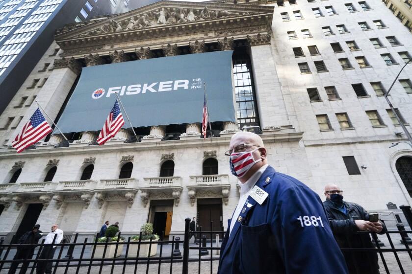 Stock trader Thomas Ferrigno arrives to work at the New York Stock Exchange on Monday.