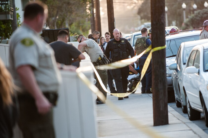 Police secure an area near the UC Santa Barbara campus in Isla Vista after a shooting Monday.