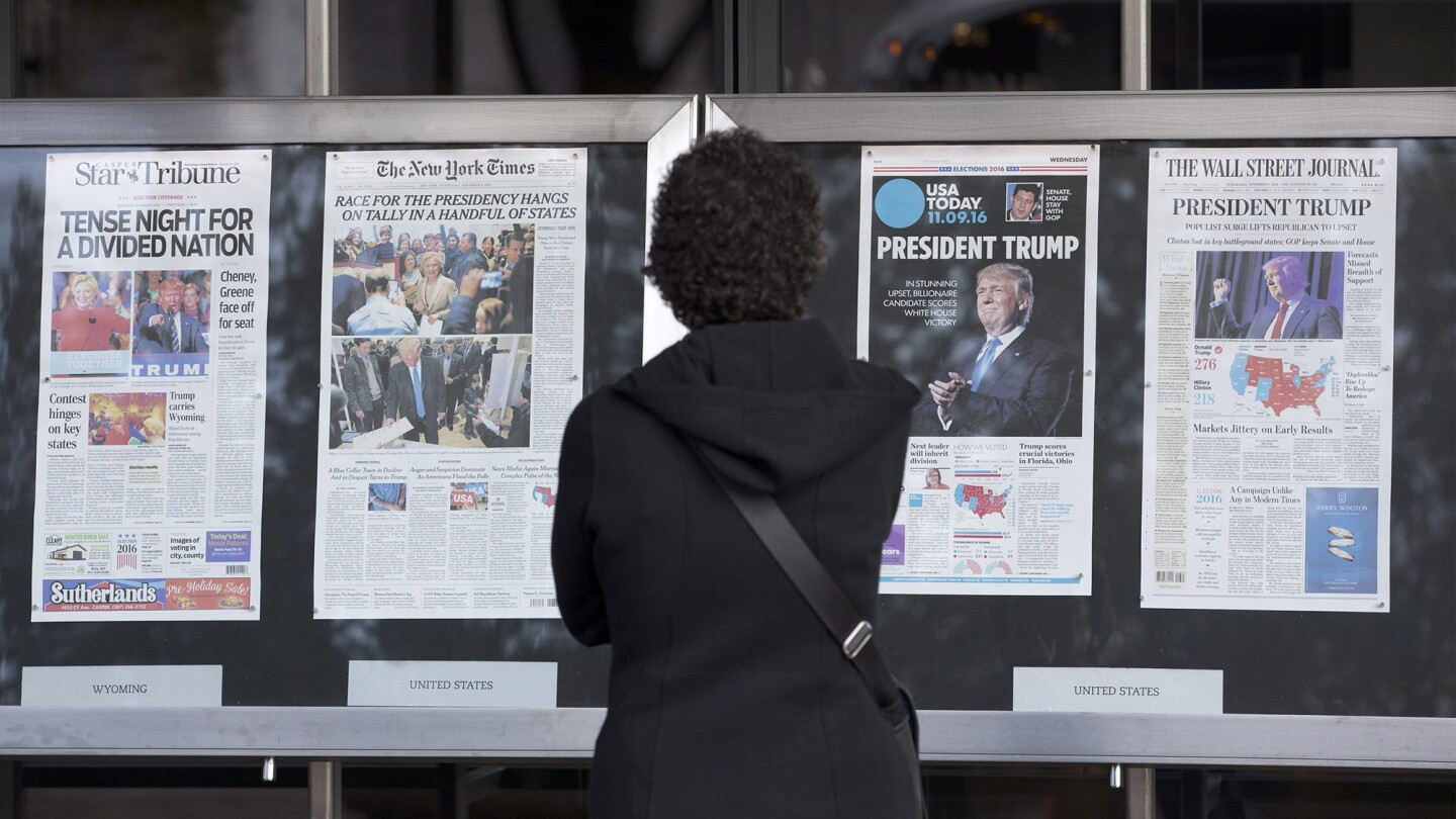 A woman looks at election coverage on the front pages of today's newspapers on display outside the Newseum in Washington, D.C. The victory of Republican presidential candidate Donald Trump surprised many in the country after weeks of polling data appeared to indicate Hillary Clinton was poised to win.