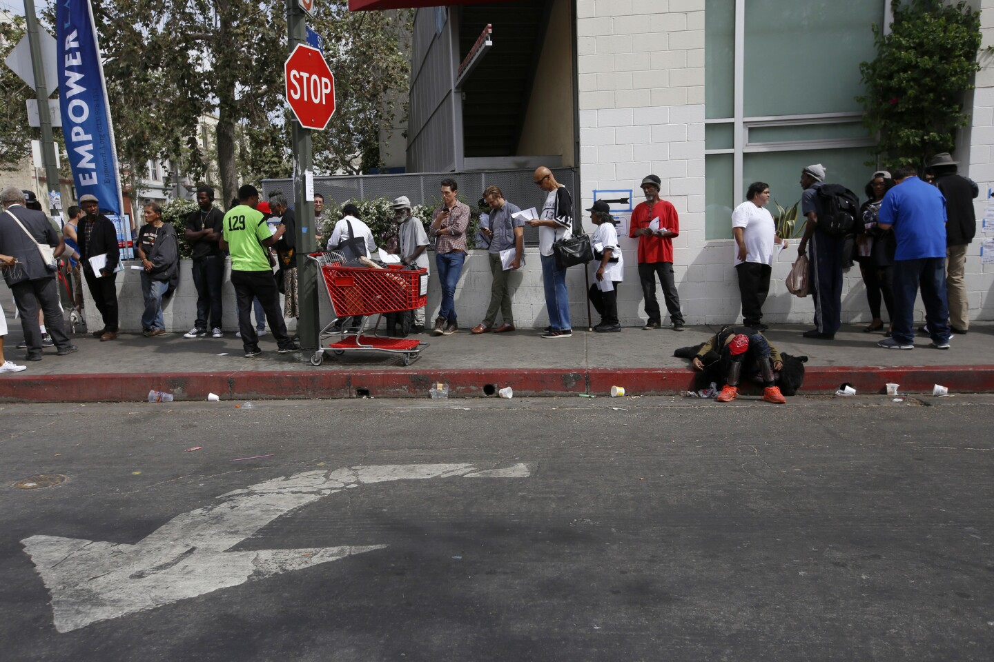 People line up to vote on the corner of 5th and San Julian streets in the skid row neighborhood of Los Angeles.