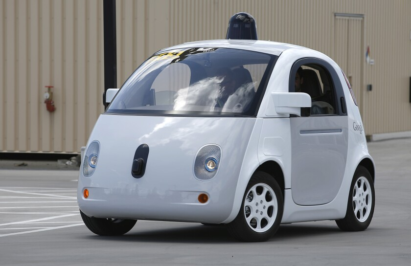 Google's self-driving prototype car drives around a parking lot during a demonstration at the Google campus in Mountain View, Calif., last year.