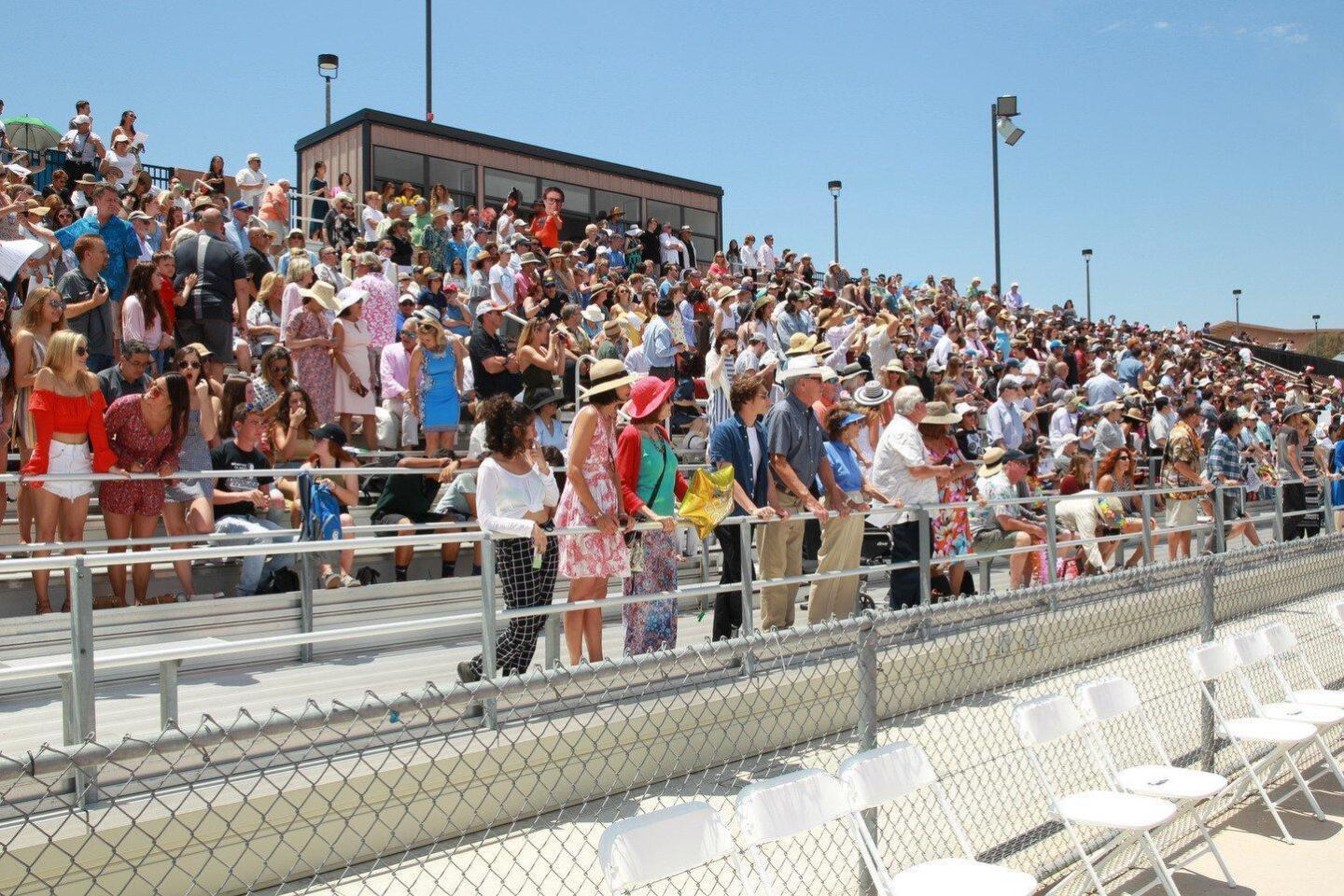Family and friends cheer on the CCA graduates