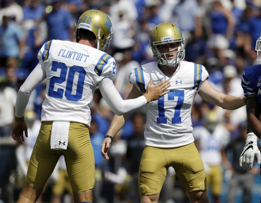 UCLA place kicker J.J. Molson (17) is congratulated by holder Stefan Flintoft (20) after kicking a 33-yard field goal against Memphis during the first half on Sept. 16, 2017.