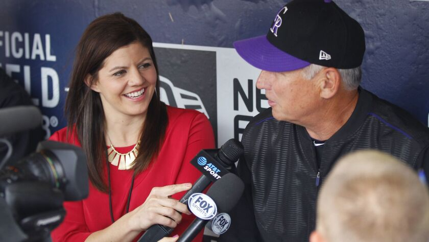 Colorado Rockies broadcaster Jenny Cavnar interviews manager Bud Black before a game at Petco Park in San Diego on May 14, 2018.