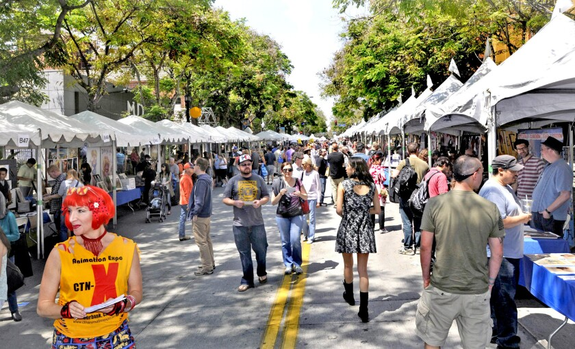 Hundreds attend the Downtown Burbank Art Festival along San Fernando Boulevard in the spring of 2015. The Burbank Planning Board reviewed a draft of the city's Complete Street Plan, which proposes converting San Fernando into a one-way street.