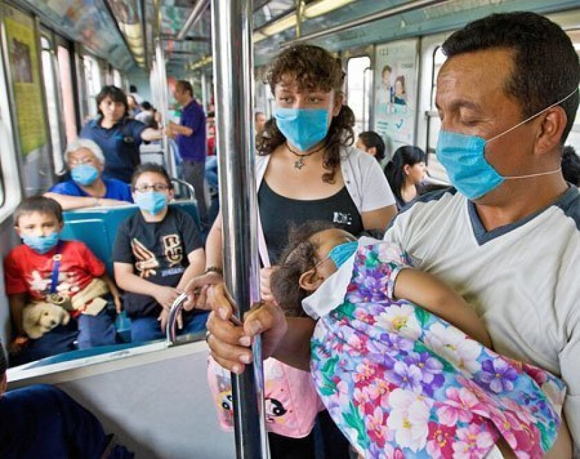 Commuters tried to guard themselves from swine flu while traveling yesterday on Mexico City's subway. Mexico's government canceled schools and public events to halt the flu's spread. (Ronaldo Schemidt / AFP / Getty Images)