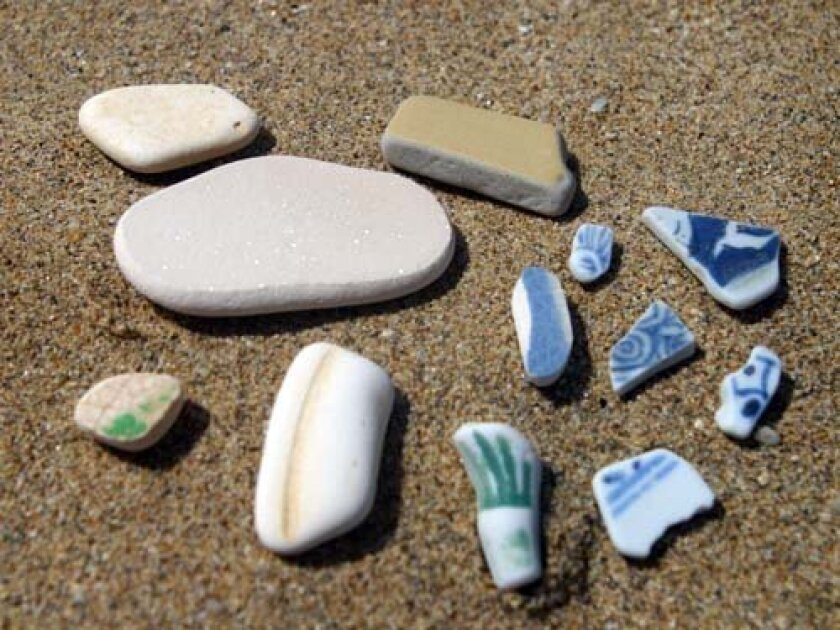 Tiny pieces of tile, pottery and china that have been tumbling in the surf for years. Photo: Kelly Stewart