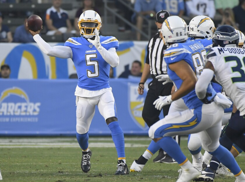Chargers quarterback Tyrod Taylor looks to pass against the Seahawks in the first quarter Aug. 24, 2019.
