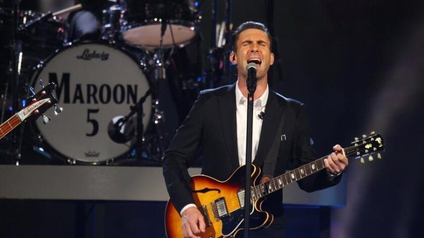 Adam Levine, of the musical group Maroon 5, performs at the night that changed America: a Grammy salute to the Beatles, on Monday, Jan. 27, 2014, in Los Angeles. (Photo by Zach Cordner/Invision/AP) - The Associated Press