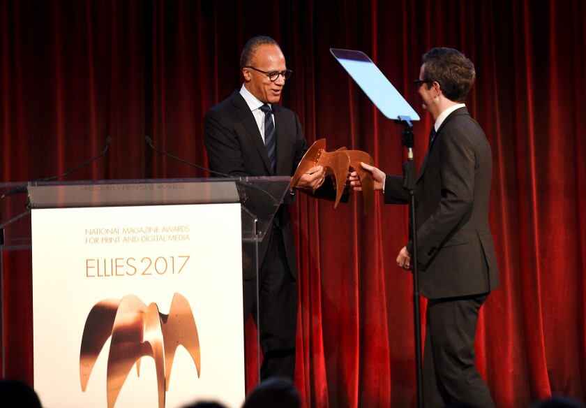 Douglas McGray accepts an award  from Lester Holt.