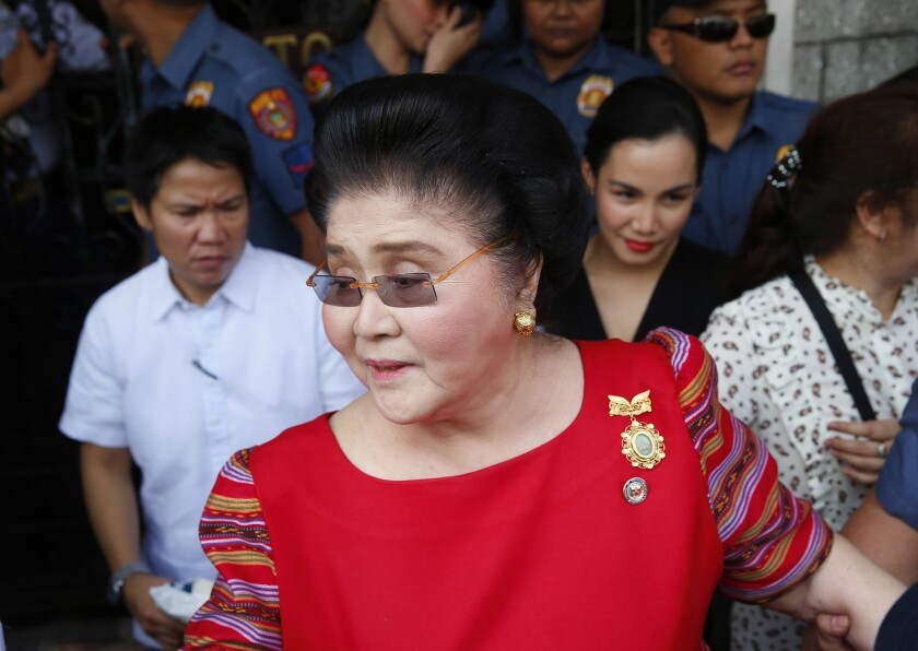 Former First Lady and widow of the late dictator Ferdinand Marcos, Congresswoman Imelda Marcos arrives at the Commission on Elections, Oct. 16, 2018, in Manila, Philippines.