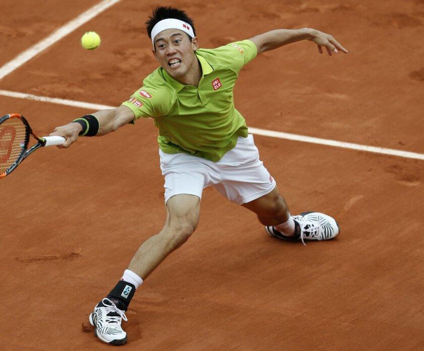 Japan's Kei Nishikori returns the ball to Spain's Fernando Verdasco during their third round match the French Open tennis tournament at the Roland Garros stadium, Friday, May 27, 2016 in Paris. (AP Photo/Alastair Grant)