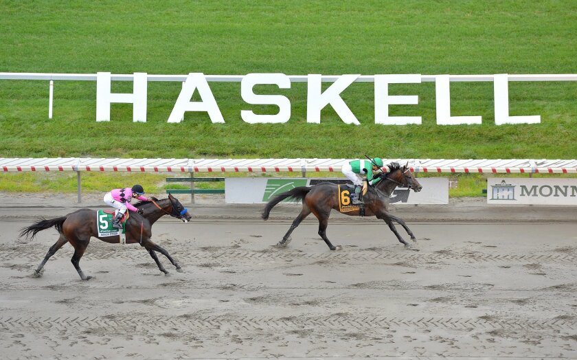 In a photo provided by Equi-Photo, Exaggerator, right, with Kent Desormeaux riding, wins the $1 million Haskell Invitational horse race at Monmouth Park in Oceanport, N.J., on Sunday, July 31, 2016. (Joe Labozzetta/Equi-Photo via AP)