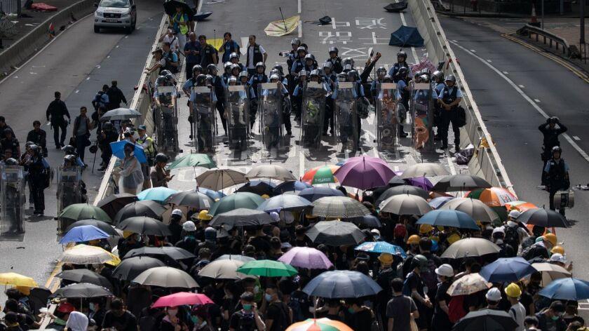 Anti-extradition protesters block roads near the Legislative Council, Hong Kong, China - 01 Jul 2019