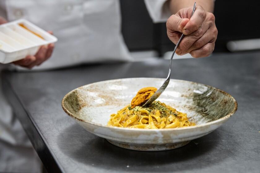 Chef Ramir DeCastro prepares the uni pasta at Robata En in Las Vegas.