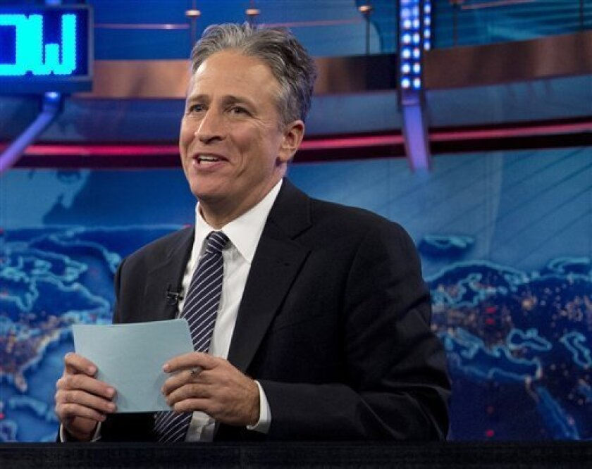"""FILE - In this Oct. 18, 2012 file photo, Jon Stewart speaks during a taping of """"The Daily Show with John Stewart"""", in New York. The U.S. Embassy in Cairo has at least temporarily shut down its Twitter feed following an unusual diplomatic incident involving """"The Daily Show"""" host Jon Stewart and the Egyptian government. (AP Photo/Carolyn Kaster, file)"""