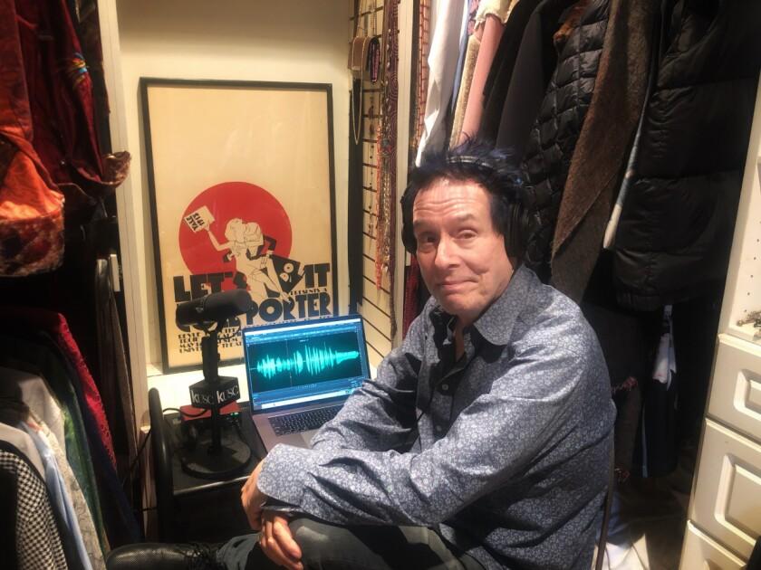 KUSC host Alan Chapman in his closet/home studio.