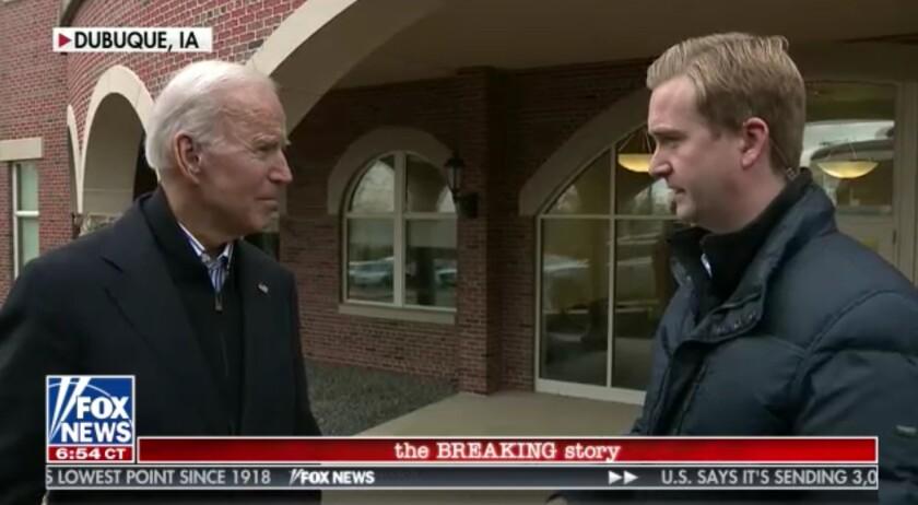 Presumptive Democratic presidential nominee Joe Biden, left, with Fox News reporter Peter Doocy in Dubuque, Iowa, in 2019.