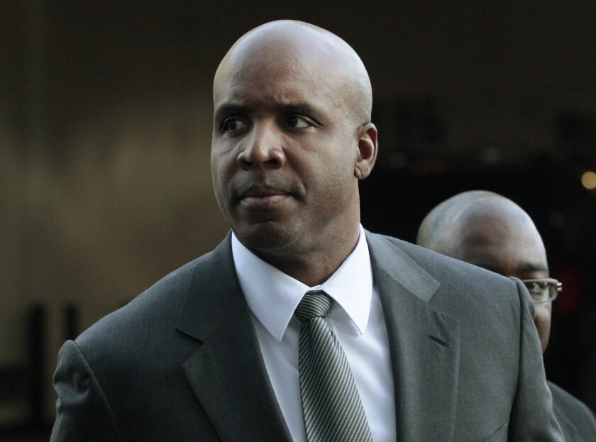 FILE - In ta March 29, 2011, file photo, former baseball player Barry Bonds arrives for his trial at federal court in San Francisco.  Federal prosecutors Tuesday April 28, 2015, are considering whether to ask the U.S. Supreme Court to reinstate Barry Bonds' obstruction of justice conviction.    (AP