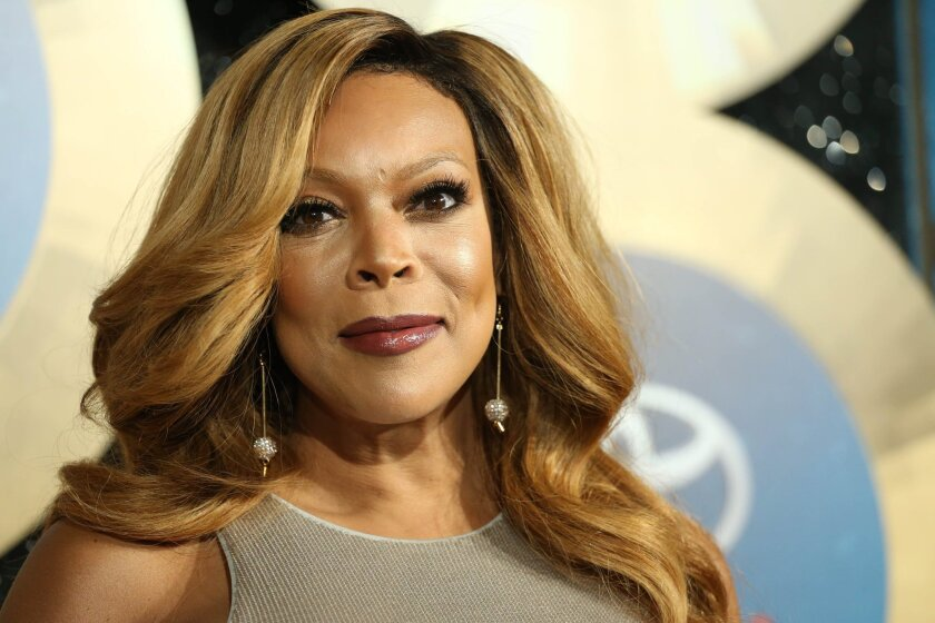 """FILE - In this Nov. 7, 2014, file photo, TV talk show host Wendy Williams arrives during the 2014 Soul Train Awards in Las Vegas. Williams has hosted her own talk show since 2008. Williams blatantly stole the """"Hot Topics"""" idea from, """"The View"""" and expanded the amount of time she chats about pop cul"""