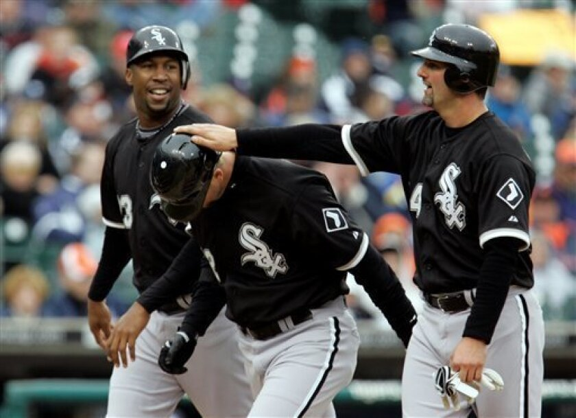 Chicago White Sox batter A.J. Pierzynski, center, is congratulated by teammates Paul Konerko, right, and Jermaine Dye after his three-run home run during the seventh inning of a baseball game against the Detroit Tigers in Detroit, Friday, April 4, 2008. (AP Photo/Carlos Osorio)