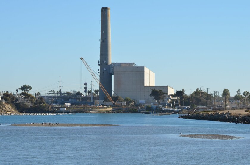 Every few years, the owners of the Encina Power Station have to dredge the Agua Hedionda lagoon's outer basin to keep sand from blocking the flow of ocean water needed to cool the plant's steam generators.